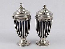 A pair of urn shaped late Victorian silver peppers with blue liners, (one A