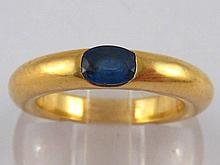 Cartier. A French hallmarked 18 carat gold sapphire ring by Cartier, signed