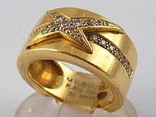 Mauboussin . An 18 carat gold diamond ring by Mauboussin, signed and number