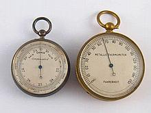 An aneroid barometer and a gilt metal thermometer, both with suspension loo