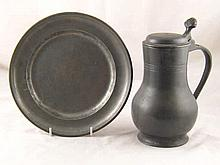 A late 18th century pewter plate, approx. 23 cm diameter, and a pewter tapp