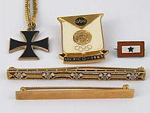 A mixed lot comprising two bar brooches marked 14k (6.4 gms), a sterling an