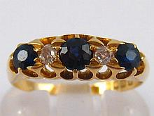 An 18 carat gold sapphire and diamond five stone ring, size Q, 3.7 gms.