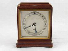 A square mahogany mantel clock on pad feet in the 1930s style with eight da