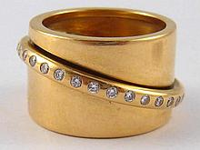 A French 18ct gold and diamond ring,  the diamond set band rotating freely