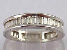 A 14ct white gold diamond eternity ring  the baguette cut diamonds measurin
