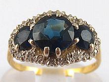 An 18 carat gold sapphire and diamond ring, largest sapphire approx 7.3mm d
