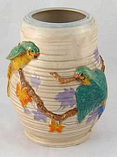 A ceramic vase, the beige striated body moulded with brightly coloured budg