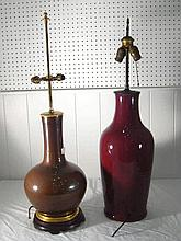 A tall antique Chinese ceramic bottle shaped table lamp with heavy streaked