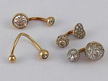 A mixed lot comprising four items of piercing jewellery, three hallmarked 9