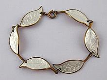 A Danish silver gilt and white enamel bracelet designed by  Willy Winnaess