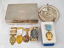 Five masonic jewels, a silver tazza on tripod mount, 12cm. across, and a si