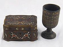 A brass cased shaped  velvet lined mahogany jewel box with cut corners. Inl