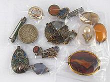 A mixed lot comprising ten brooches and seven pendants, all untested, some