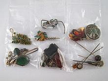 A mixed lot including brooches, bracelets, stick pins etc. All untested, in