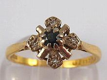 An 18 carat gold sapphire and diamond ring, size Q, 3.1 gms.