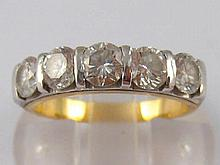 A yellow metal (tests 18 carat gold) five stone diamond ring, the round bri