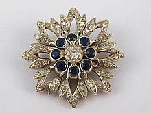 A yellow and white metal (tests 9 carat gold and silver) sapphire and diamo