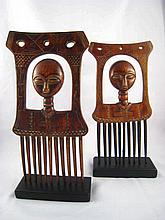 A pair of Ashanti tribe combs, each with a head on a tall ringed neck, circ