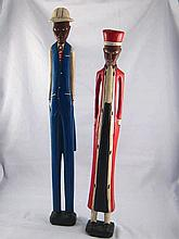 A pair of Colonial wooden figures , Ivory Coast , circa 1960, hts 55&60 cm.
