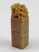 A Chinese hardstone seal , the capital carved with a dragon seizing the fla