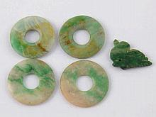 Four jade discs, each 2.5cm. diameter, together with a jade bird pendant.