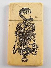 A Chinese ivory card case engraved and filled with figures and snakes. 8.5x