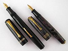 A Unique fountain pen with three trim bands cap,