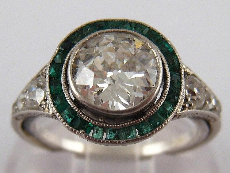 An Art Deco emerald and diamond ring, the