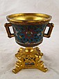 A gilt bronze champleve enamelled two handled