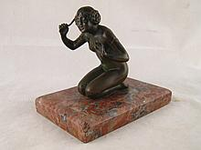 A bronze of a kneeling nude, ht. 11cm on a granite
