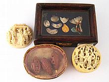 A box containing an ivory plaque of a scribe