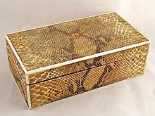 An Art Deco lizard skin and ivory mounted box,