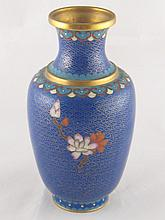 A brass vase cloisonne enamelled in blue with a