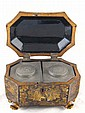 A fine Chinese lacquer tea caddy on claw feet, the