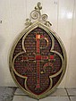 A cast iron lunette shaped ecclesiastical wall