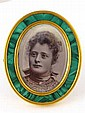 A Russian oval photo frame, the gilt mounted