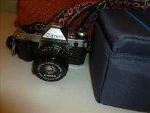 Cannon camera with case strap--AE-1-program- 35mm