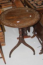 19th cent. Oak tilt top table with carved top.