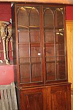 19th cent. Mahogany bookcase on cupboard, 12 glaze