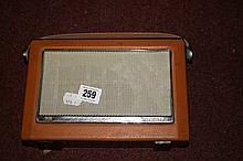 Radios: Bush model TR 130, portable radio.