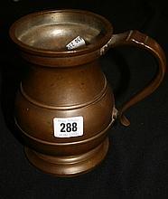 19th cent. Bronze baluster quart tankard with tinn