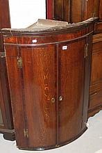 19th cent. Mahogany and oak bow fronted, wall moun