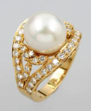 18 kt gold ring with pearl and brilliants
