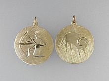 2 zodiac sign pendants, YG 585/000, approx. 9.0 g,