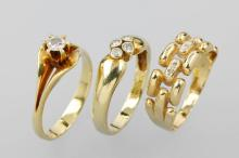 Lot 14 kt gold rings with diamonds