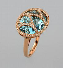 18 kt gold ring with topaz and diamonds