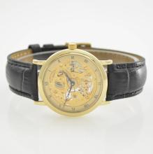 Skeletonised 14k yellow gold gent's wristwatch