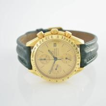 OMEGA chronograph series Speedmaster in 18k yellow gold