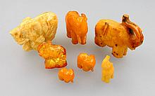 Lot 7 elephants made of amber